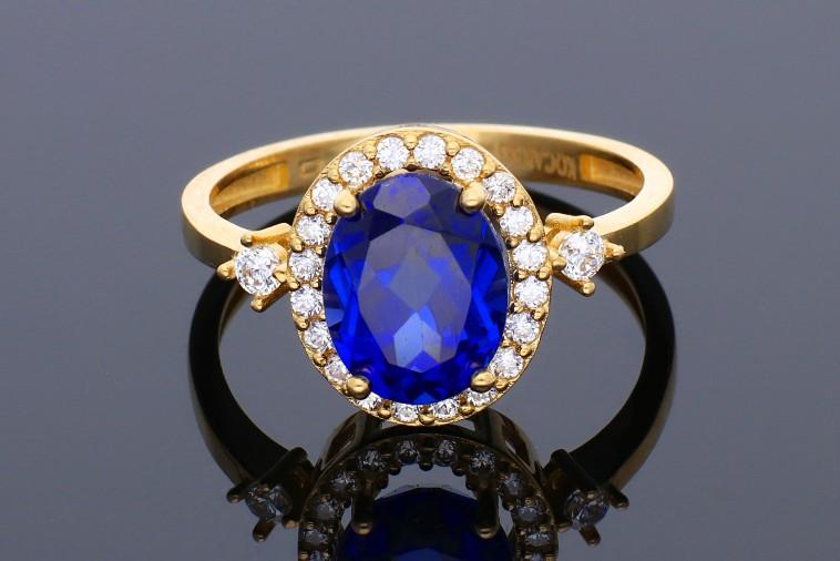 Inel din aur 14K galben anturaj zirconia albastru